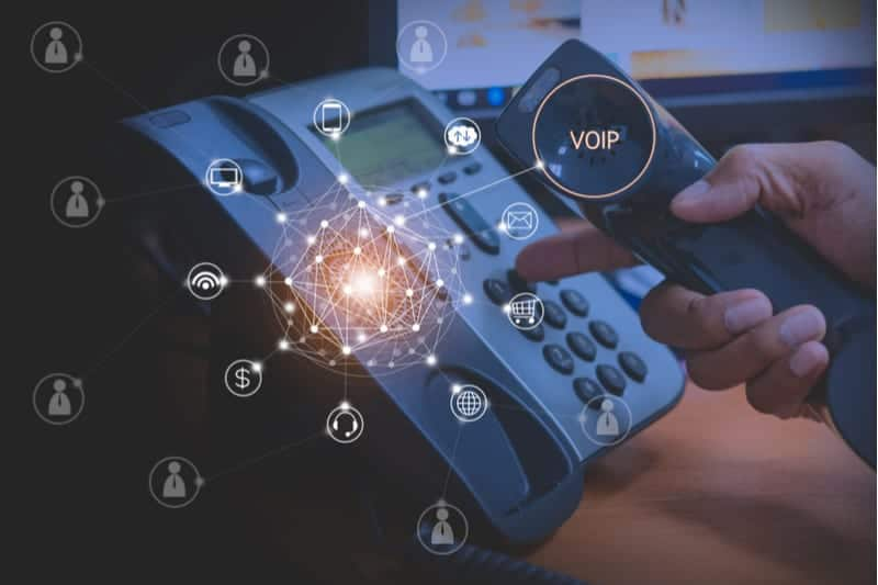Person dialing a phone number on a VOIP phone